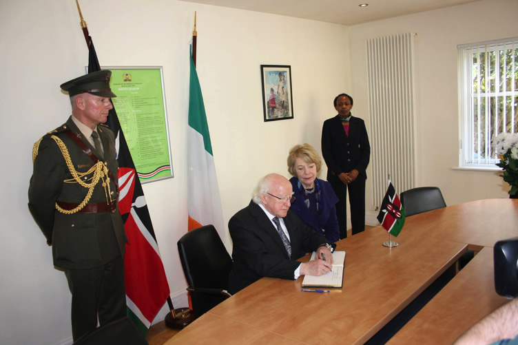 President Michael D. Higgins and his wife, Sabina Higgins signing the book